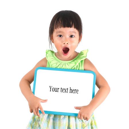 Little asian girl holding whiteboard photo