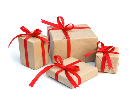 gift parcel: gift box wrap brown paper with red ribbon and isolated background