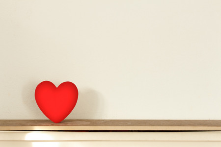 red heart on warm tone background photo