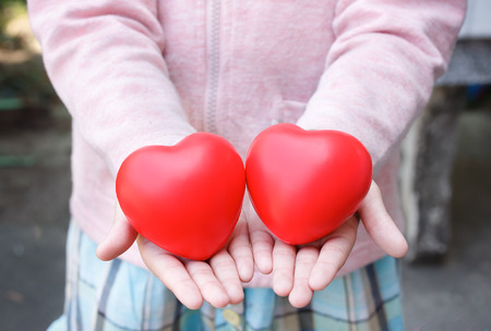 cuople heart on child hand photo