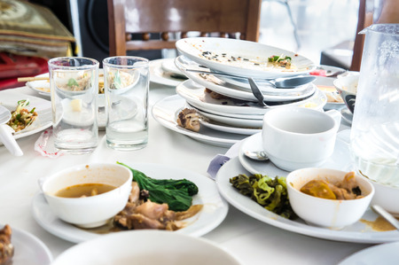 filthy: dirty dishes on table