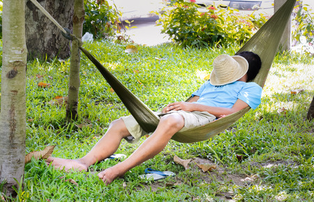 man sleep in a hammock