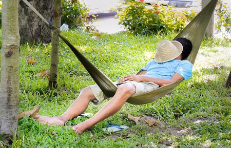 man sleep in a hammock