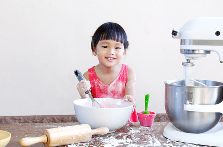 little chinese girl making bakery