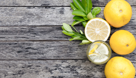 lemon juice on wood plank background