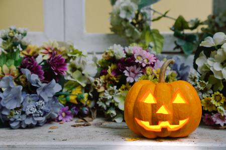 to shade: halloween pumpkin in dark shade flower scene Stock Photo
