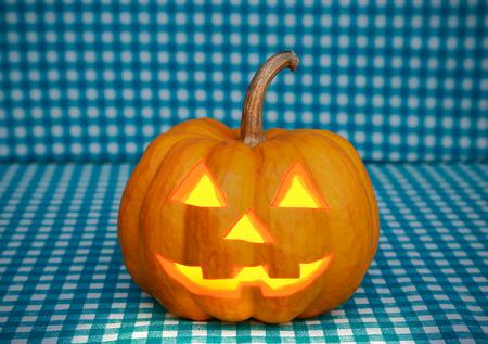 jack o lantern: halloween pumpkin on blue cloth