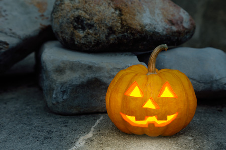 jack o  lantern: halloween pumpkin in rock scene Stock Photo