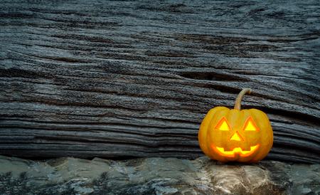 jack o  lantern: halloween pumpkin on dark wood texture scene