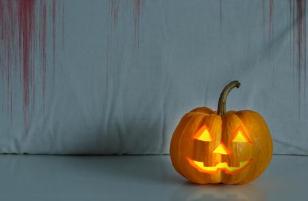 jack o  lantern: halloween pumpkin in blood horror scene