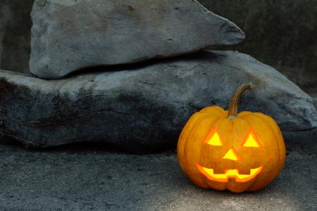 jack o  lantern: halloween pumpkin in dark rock scene