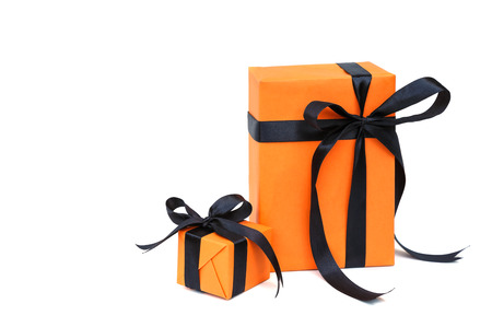 gift: Halloween gift  orange color gift box with black bow isolated on white