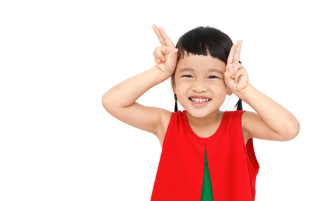 playful: Playful little girl with red christmas dress