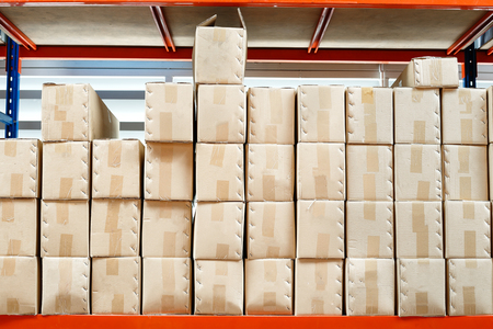 brown box: brown box parcel  on shelf in warehouse