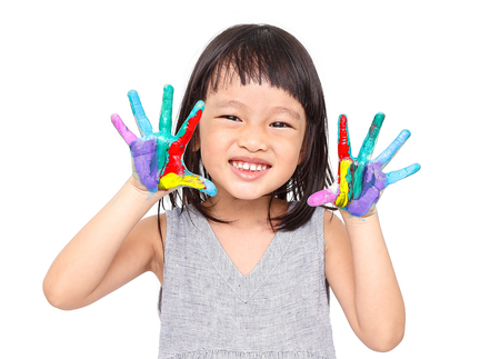 chinese little girl with hands in the paint