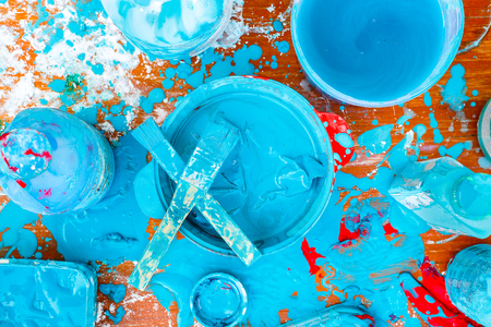 mess: blue color mess paint on wood floor