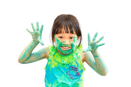 naughty girl: cute cheerful happy little girl naughty in green paint
