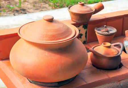 red clay: red clay potery in asian kitchen style Stock Photo