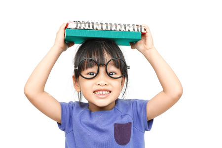 fun background: asian happy girl hold a book on her head with isolated white background
