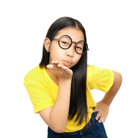 gorgeous girl: asian young girl blowing a kiss on white background Stock Photo