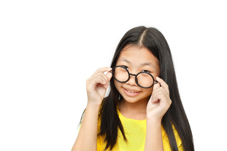 business skeptical: Asian young girl with glasses looks questioningly