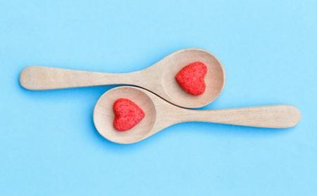 sugar candy shape heart on wooden spoon