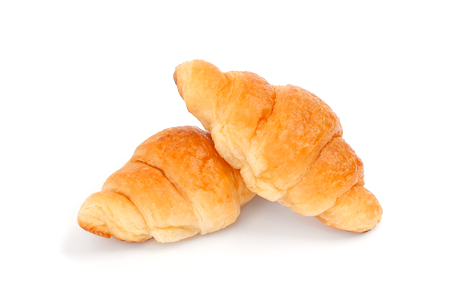 traditionally french: Fresh and tasty croissant isolated on white background Stock Photo