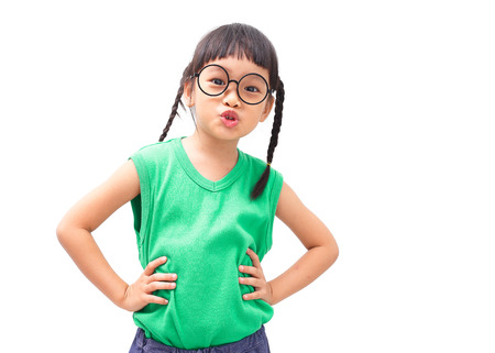 arms akimbo: Little asian girl with arms akimbo isolated on white background