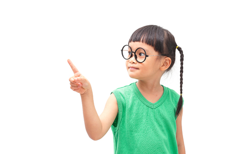 fringes: asian little girl  pointing with finger on white background Stock Photo