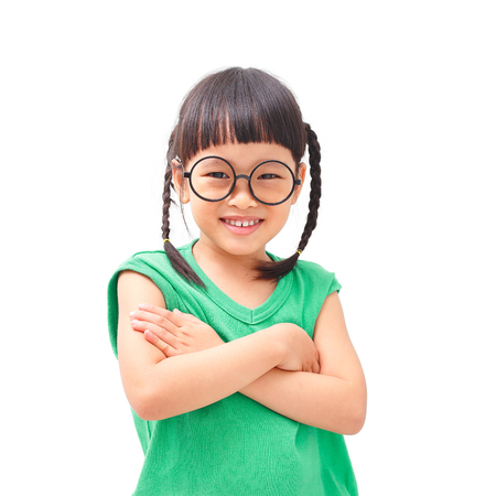 fringes: Asian little girl with folded arms Stock Photo