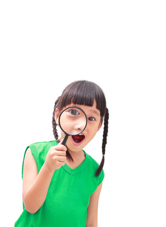 fringes: asian little girl looking through a magnifying glass