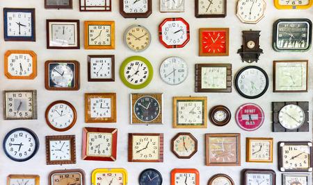 metal wall: Vintage wall clocks variety of styles Stock Photo