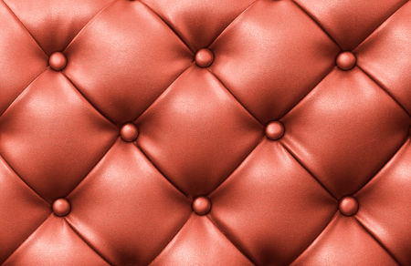 Genuine red leather upholstery background Stock Photo
