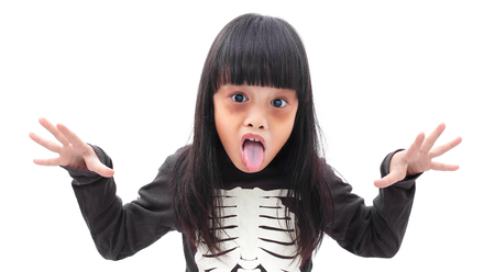 Little girl in Halloween zombie make up isolated on white background