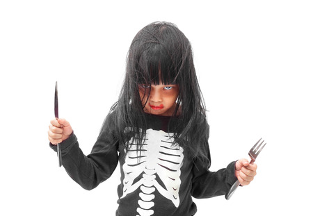 skeleton costume: Little girl in Halloween zombie make up isolated on white background
