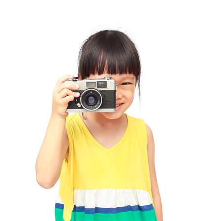 Little girl takes picture with vintage camera