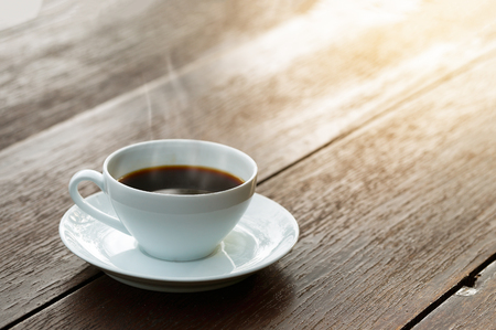 A cup of coffee on wooden table Stock Photo