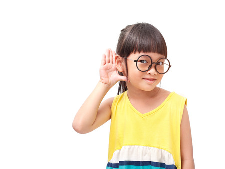 action girl: Little asian girl in hearing action Stock Photo