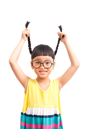 Asian little girl with raise her pigtail Stock Photo