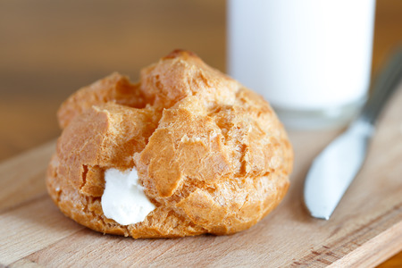 Choux cream with milk on cutting board Stock Photo
