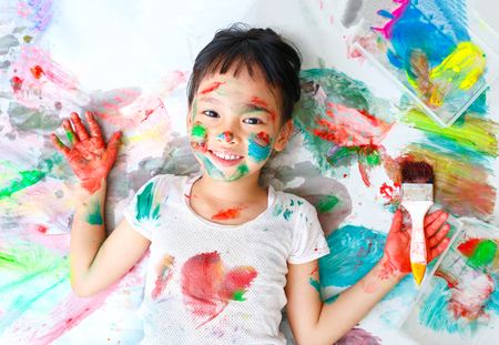 Little girl naughty with colorful paint 스톡 콘텐츠