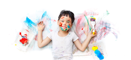 Little girl naughty with colorful paint Stockfoto