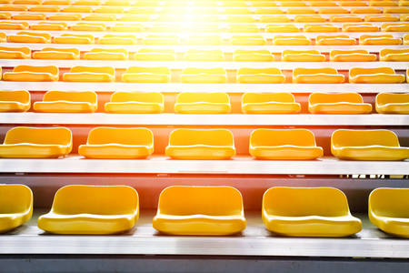 Rows of stadium grandstand seats with lighting  effect