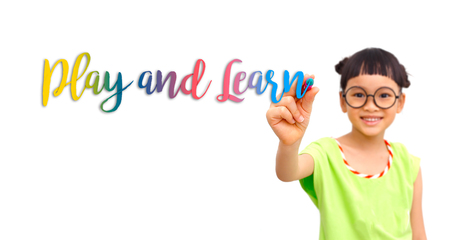 Little girl writing play and learn word in the air