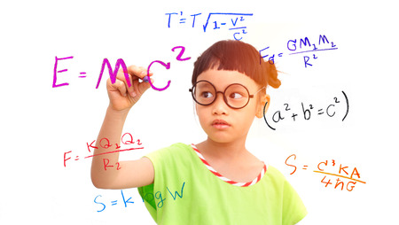 Little girl genius working on a mathematical equation 스톡 콘텐츠