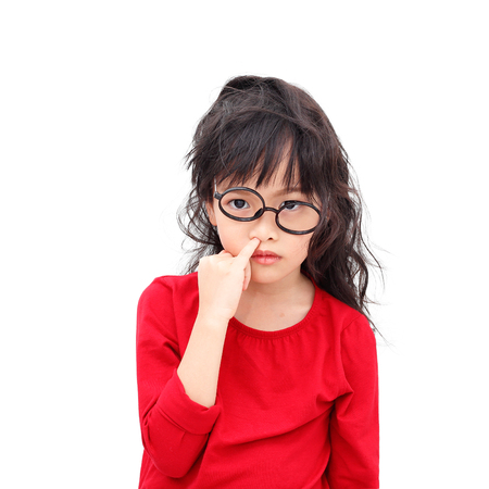 Asian little girl picking a nose with bugging face isolated on white background Stock Photo