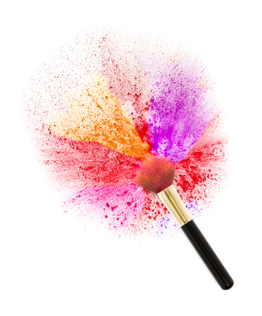 Cheek brush with cosmetic powder color splash and isolated on white background