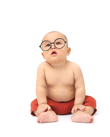 Cute baby wear big glasses and red pant isolated on white background Stock Photo