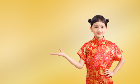 Chinese girl open palm hand isolated on gold color background.