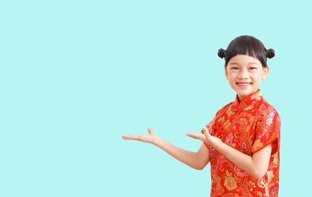 Chinese little girl open palm hand isolated on blue background.
